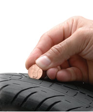 http://www.2carpros.com/forum/automotive_pictures/248015_Worn_Tire_Penny_Test_1.jpg