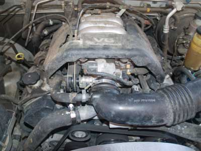 Honda Passport 1998 Honda Passport Replacing Thermostat on radiator upper hose honda