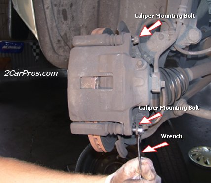 Removing Brake Caliper Mounting Bolts