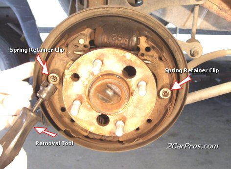 Release Rear Brake Spring Use the brake spring tool to remove the