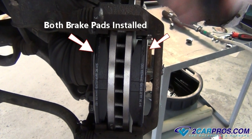 Both Brake Pads Installed on Front Brake Pad Spring Clips