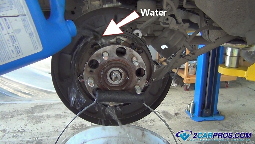 Attach A Bucket Under The Parking Brake Shoes Use Water To Clean Before Disassembly