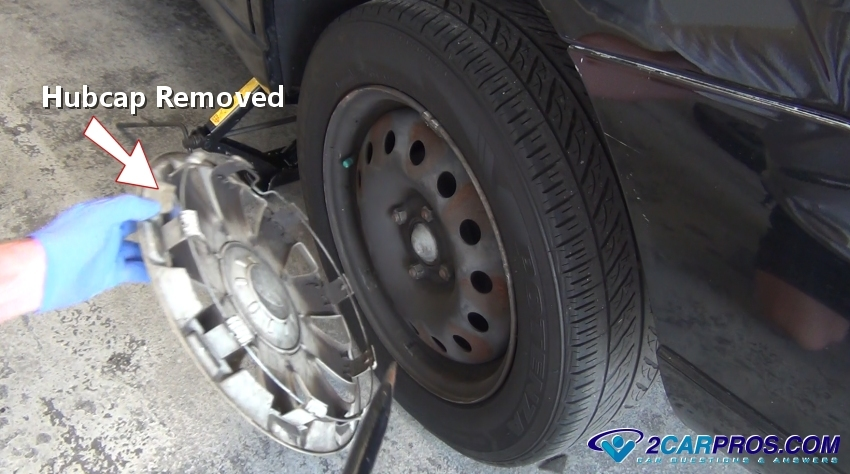 Here is an example of a lug nut cover on an aluminum wheel which has plastic covers over them which must be removed to access. These plastic covers are made ...