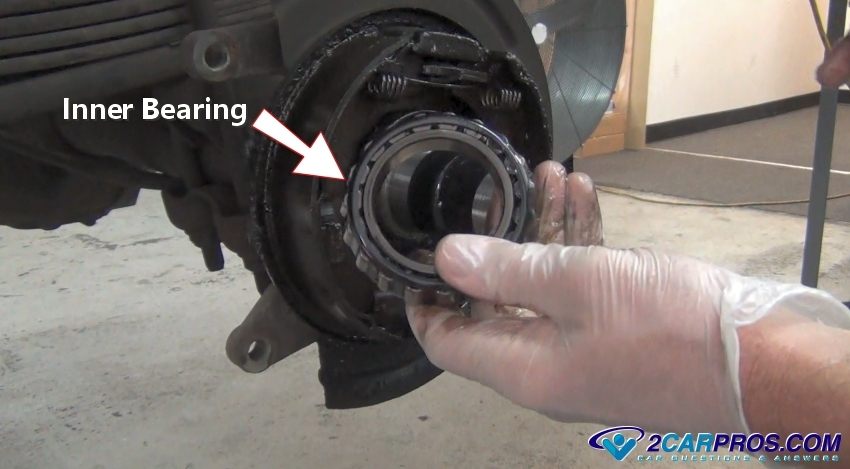 car axle bearing. next, use a large screwdriver or pry bar to force the oil seal from differential. this is wedged between differential housing and bearing car axle