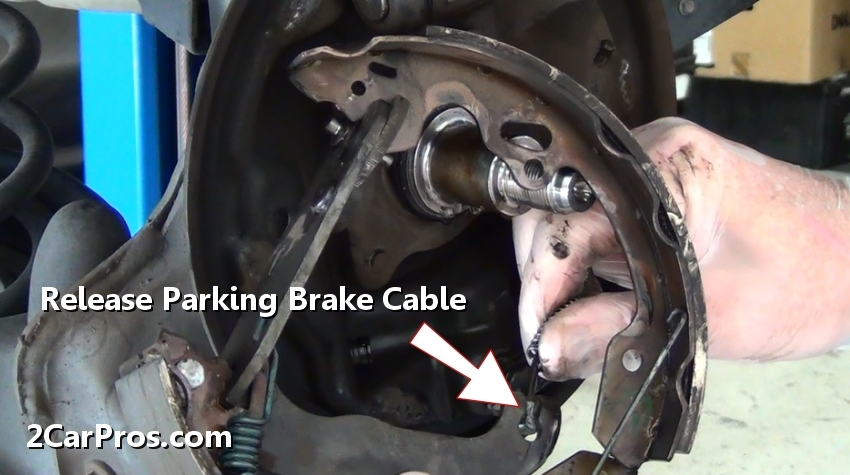 Once The Brakes Shoes Are Free From Backing Plate Pull Parking Brake Cable Spring Downward And Release Arm