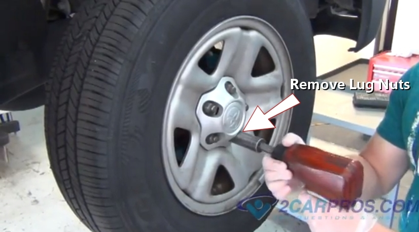 Car Repair World How To Replace Front Brake Pads And Rotors On Rear Wheel Drive Vehicles